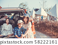Family Posing For Selfie back to Car Packed For Road Trip 58222161