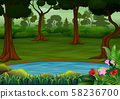 Dark forest scene with many trees and small pond 58236700