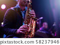 musician with saxophone 58237946