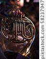 man playing a horn 58237947