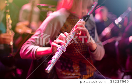 woman playing flute 58237949