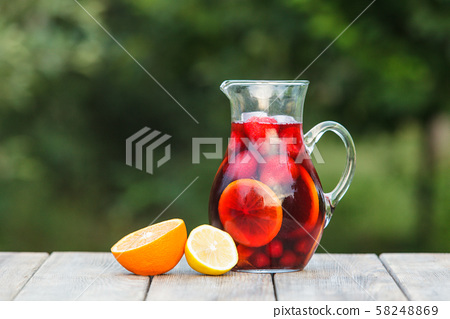 Refreshing sangria or punch with fruits in pincher 58248869