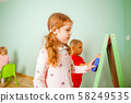 Children play and learn with magnetic board 58249535