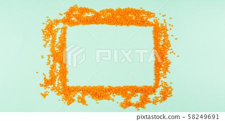 Flat lay lentil frame on mint green 58249691