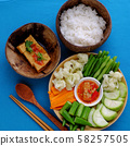 top view tray food, boiled vegetables, tofu, rice on blue background 58257505