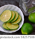 Top view lemons and lime slices detox water 58257506