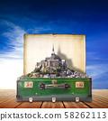 Mont Saint Michel abbey in suitcase 58262113