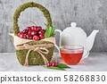 White teapot, herbal tea in glass cup and fresh 58268830