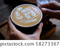 Hand Hold a Cup of Coffee. Menu Drink for Relax on Wood Table Texture and Space for your text. Lifestyle Concept Cafe Design Background.  58273367