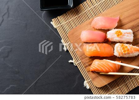 top view of Salmon sushi nigiri in chopsticks 58275783