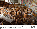Old and damaged wine and beer barrels 58276699