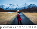 Female traveler on a scenic road in Iceland 58280336