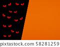 Evil eyes looking in the dark. 58281259