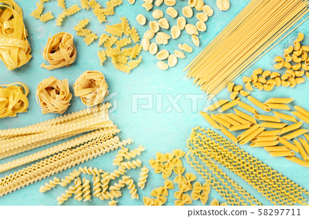 Italian pasta, flat lay banner with copy space, an overhead shot on a teal blue background, a design 58297711