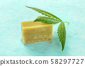 A cannabis leaf with homemade hemp soap on a blue background 58297727