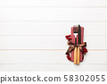 Top view of New Year dinner on wooden background. 58302055