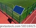 Solar panel on the rack. The panel is located on the sports field. Stadium lighting. Autonomous 58316025