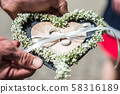 Beautiful wedding rings lie on stone surface against the stone background for a wedding couple with 58316189
