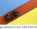 Retro vintage car on multicolored paper background. Vacation, delivery, travel concept. Top view, flat lay. Red blue yellow stipes. Diagonal direction 58318479
