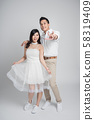 Asian couple in love in casual wedding dress 58319409