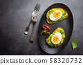 Toast with avocado and egg 58320732
