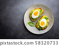 Toast with avocado and egg 58320733