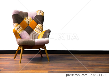 Vintage chair on wooden floor. Colored empty armchair. Vintage elements in interior. Furniture in 58321198