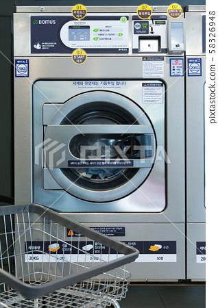 Single life concept, washing machines at laundromat 161 58326948