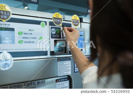 Single life concept, washing machines at laundromat 132 58326950