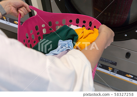 Single life concept, washing machines at laundromat 005 58327258