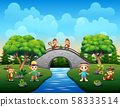 Funny children playing with monkeys 58333514