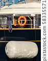 Large boat fender protecting the side of a yacht 58335571
