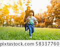 Cute 2 year old asian toddler girl exploring the 58337760