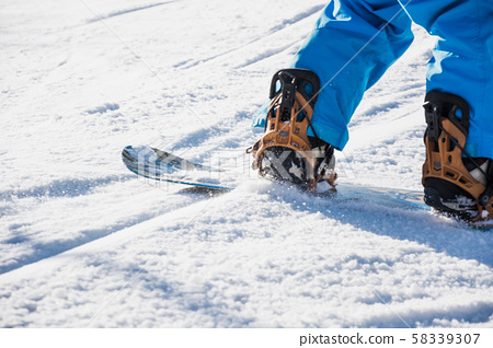 Snowboard freerider in the mountains. Winter. 58339307