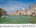 Boats and gondolas on Grand Canal in Venice, Italy 58344025