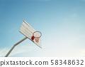 Basketball hoop on empty outdoor court 58348632