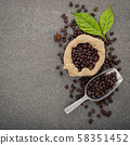 Dark roasted coffee beans on stone background. Top 58351452
