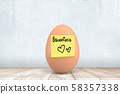 3d close-up rendering of chicken egg with yellow sticky note on with hand-drawn hearts and word 58357338
