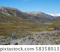 Autumn view on red Krossbu tourist station mountain hut buildings from hike to glacier Smorstabbreen 58358013