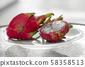 Dragon fruit. Vibrant Dragon Fruit on white background. Sliced white dragon fruit or pitaya on white 58358513