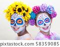 Two Teenage Girls in Dia de los Muertos Day of the Dead Halloween Make Up 58359085