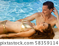 Beautiful Wealthy Rich Attractive Couple Relaxing By Swimming Pool 58359114