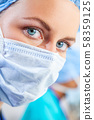 Female Woman Doctor Surgeon Wearing Scrubs and Surgical Face Mask 58359125