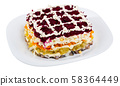 Russian dressed herring salad 58364449