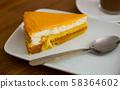 Slice of sponge cake with peach glazing 58364602