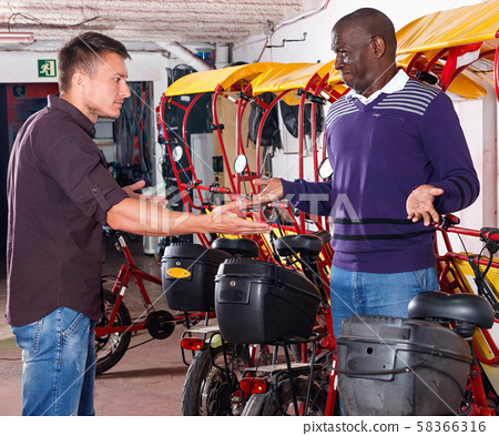 Young man client dissatisfied with rickshaw service, emotionally talking to driver 58366316