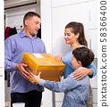 Man delivered box to happy housewife with son at home 58366400
