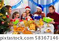 Large family exchanging gifts during Christmas dinner 58367146