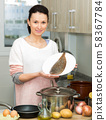 Woman holding plate with common sole 58367784