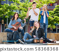 Teenagers friends playing musical instruments 58368368